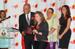 President of Haiti Michel Martelly gave a plaque to Diana Pierre-Louis, haiti experience it, se la pou'w la, logo, slogan, haiti