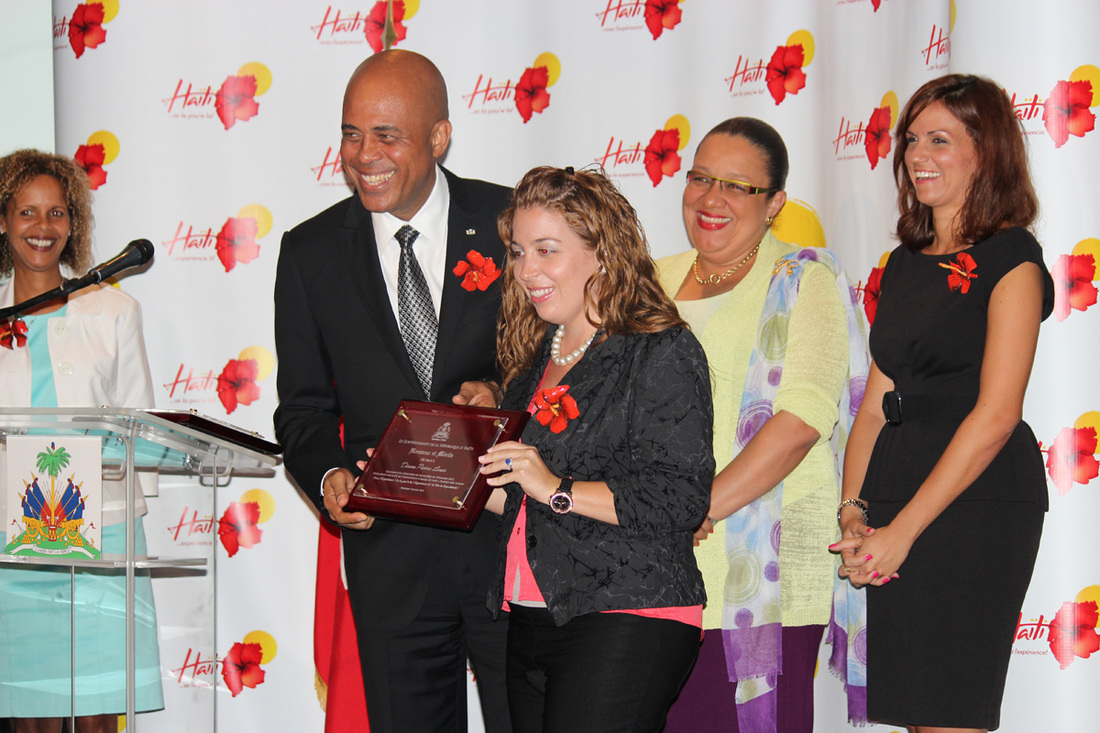 President of Haiti Michel Martelly gave a plaque to Diana Pierre-Louis