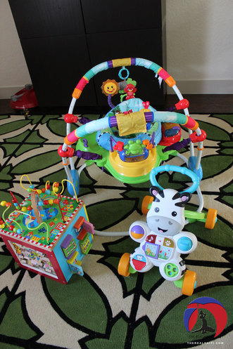 thrifted toys, garage sale, how to buy cheap toys, second hand, used, good condition, bouncy chair activity center, wood toys, toddler, baby, haiti, haitian baby, deals on toys, baby einstein, fisher price, goodwill finds