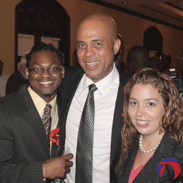 the real haiti diana pierre-louis and endy pierre-louis met former haiti president michel martelly in haiti for the ceremony for se la pou'w la contest for minister of tourism, 2012